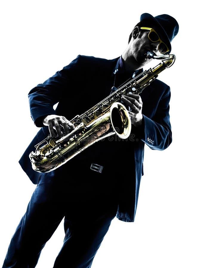 Παίζοντας φορέας saxophone saxophonist ατόμων στοκ εικόνα