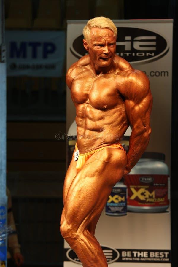Download Παγκόσμιο IBFF Bodybuilding πρωτάθλημα Εκδοτική Στοκ Εικόνα - εικόνα από άσκηση, διαγωνισμός: 17051324