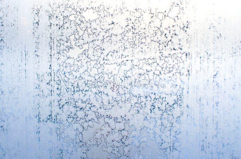 Παγωμένα σχέδια στη γυαλί-κατασκευασμένη εικόνα υποβάθρου παραθύρων στοκ φωτογραφία με δικαίωμα ελεύθερης χρήσης