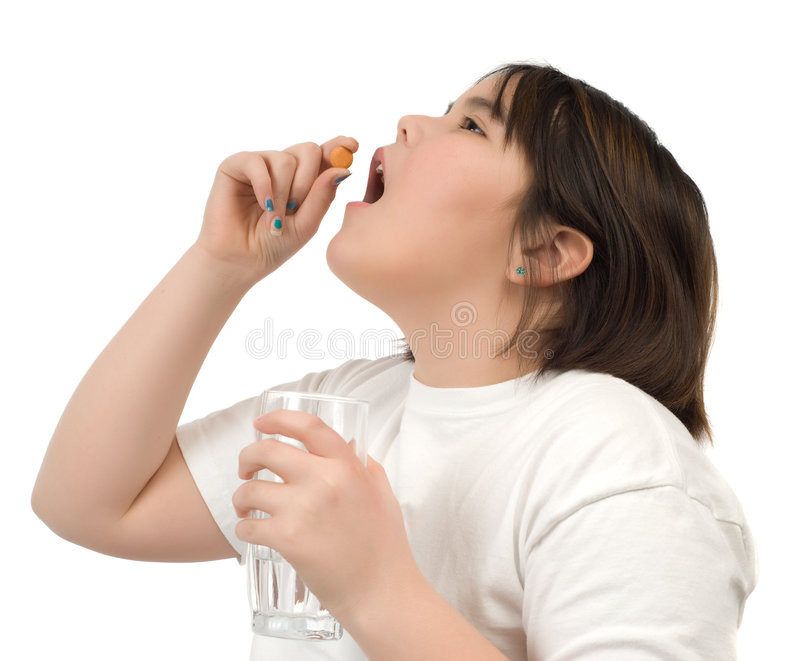 παιδί γ που παίρνει τη βιτα& στοκ φωτογραφίες