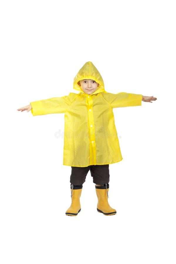 Παιδί με το αδιάβροχο στοκ εικόνες
