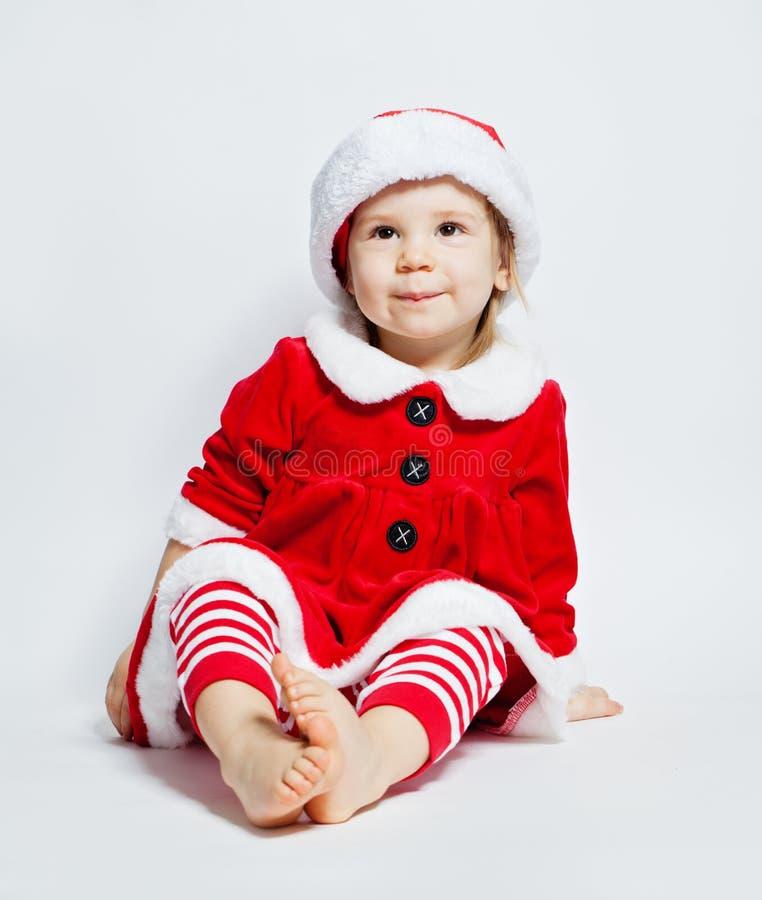 Παιδί Χριστουγέννων που φορά το χαμόγελο καπέλων Santa στοκ φωτογραφία με δικαίωμα ελεύθερης χρήσης