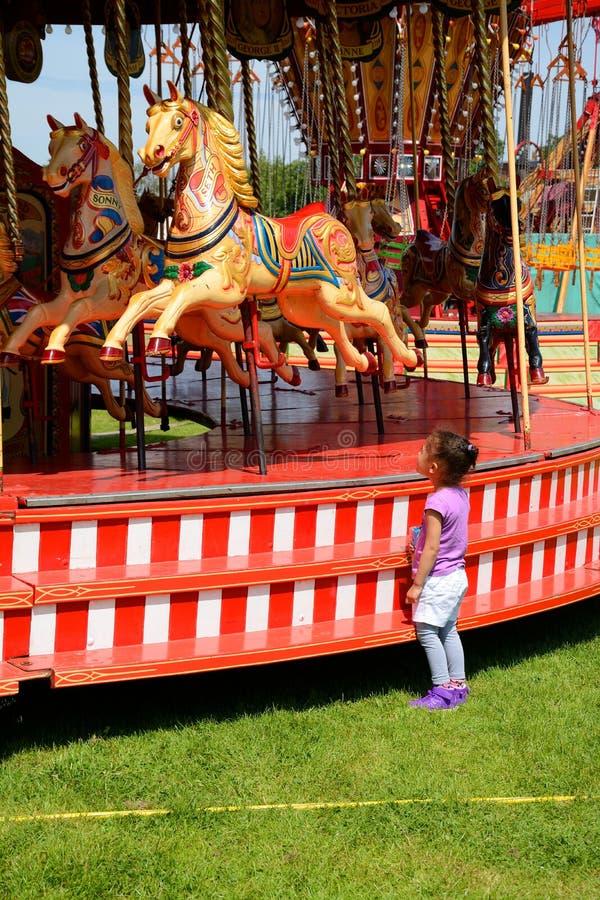 Παιδί και ιπποδρόμιο στοκ εικόνες