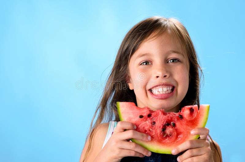 Παιδί με το καρπούζι στοκ εικόνες