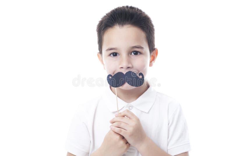 Παιδί με το πλαστό moustache στοκ εικόνες