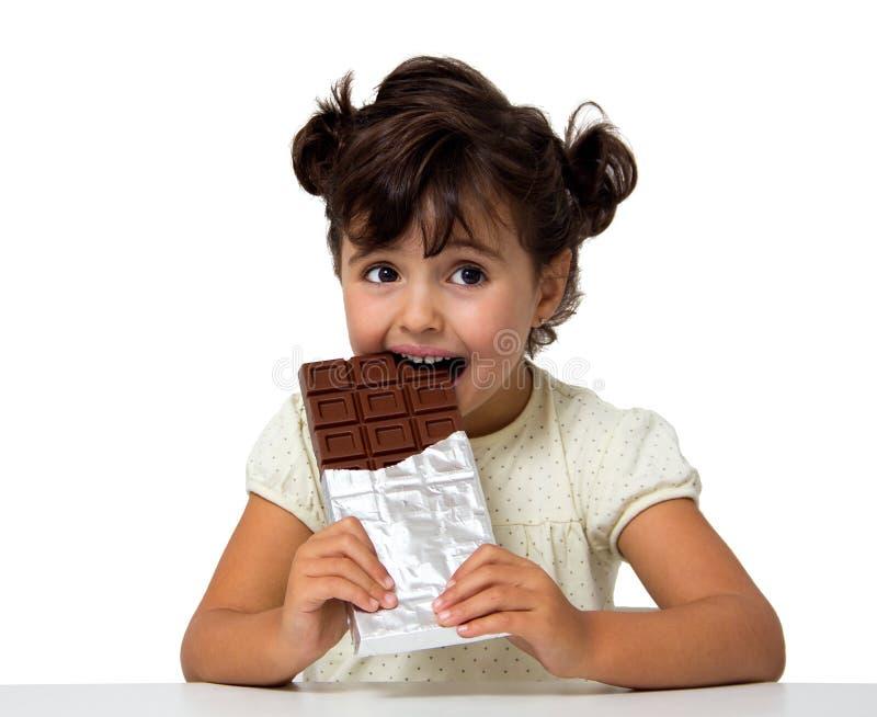 Παιδί που τρώει τη σοκολάτα στοκ εικόνες