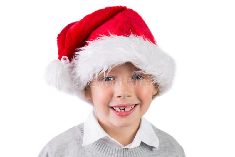 Παιδί που φορά ένα καπέλο santa στοκ φωτογραφία με δικαίωμα ελεύθερης χρήσης