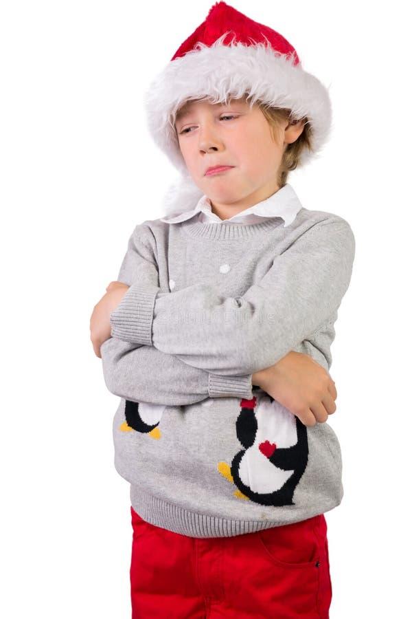 Παιδί που φορά ένα καπέλο santa στοκ εικόνες