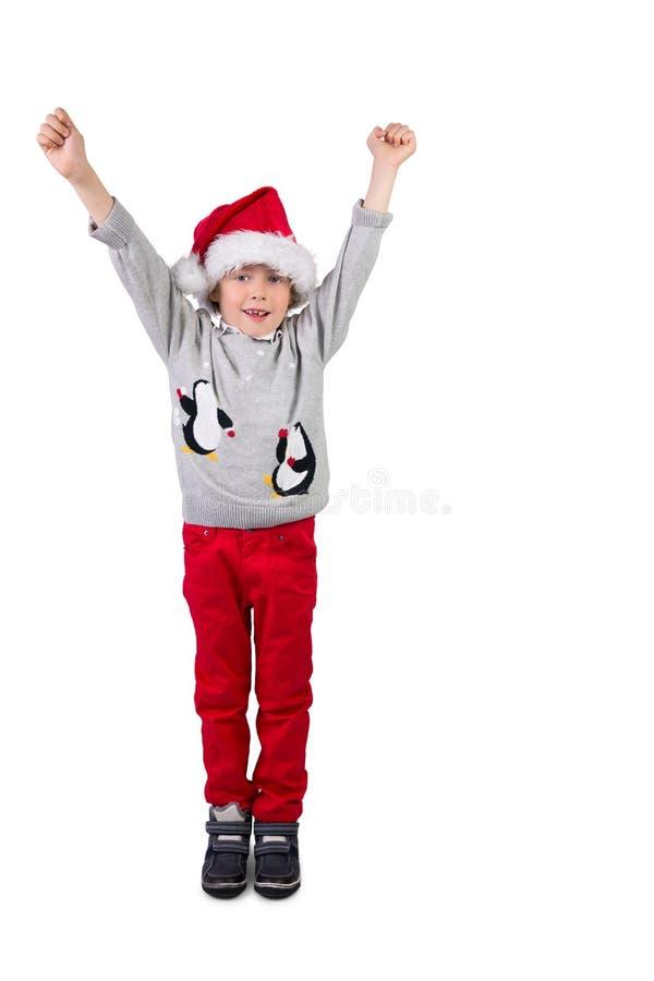 Παιδί που φορά ένα καπέλο santa στοκ εικόνα