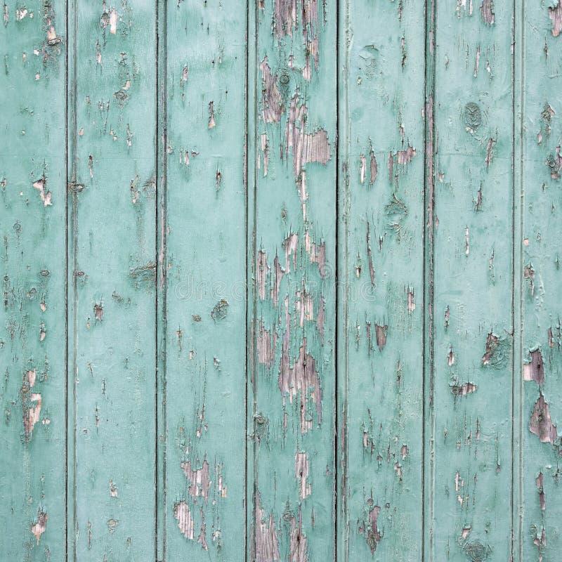 Παλαιά γαλαζοπράσινη πόρτα με το χρώμα αποφλοίωσης στοκ φωτογραφία με δικαίωμα ελεύθερης χρήσης