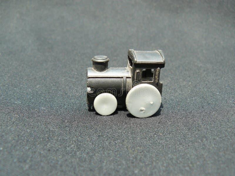 Παλαιά πλαστική μηχανή ενός παιχνιδιού τραίνων στοκ εικόνες