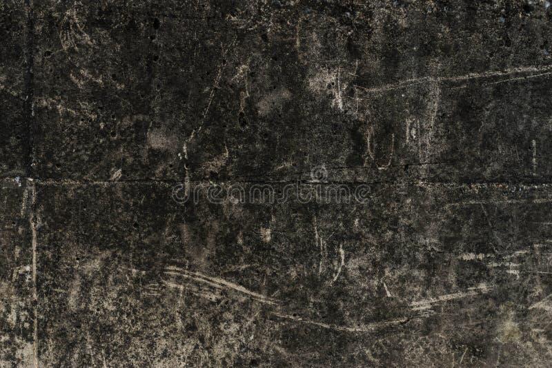 Παλαιός σκοτεινός βρώμικος συμπαγής τοίχος στοκ εικόνες