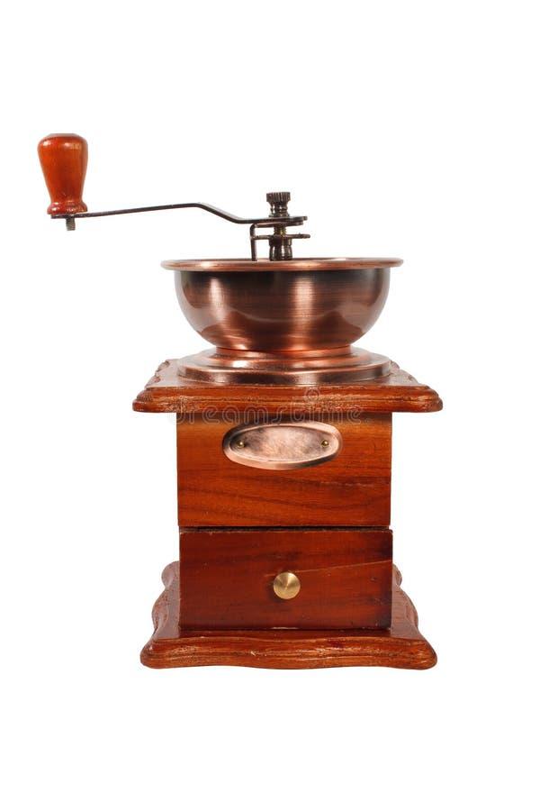 Παλαιός χειρωνακτικός μύλος καφέ σε καφετιά ξύλινη περίπτωση με τη λαβή στο άσπρο υπόβαθρο μύλος καφέ που απομονώνε&tau στοκ φωτογραφίες