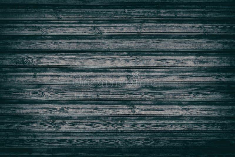 Παλαιό μαύρο με κόμπους ξύλινο υπόβαθρο των τραχιών ξύλινων πινάκων στοκ εικόνες