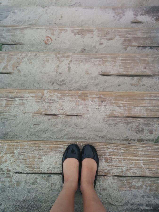 Παπούτσια στην άμμο στοκ φωτογραφίες