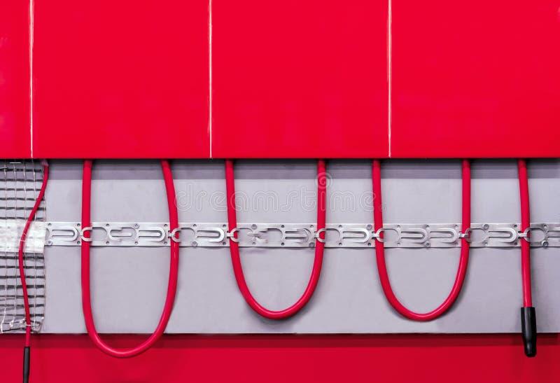 Παράδειγμα ενός συστήματος θέρμανσης πατωμάτων Έννοια ενός θερμού συ στοκ φωτογραφία με δικαίωμα ελεύθερης χρήσης