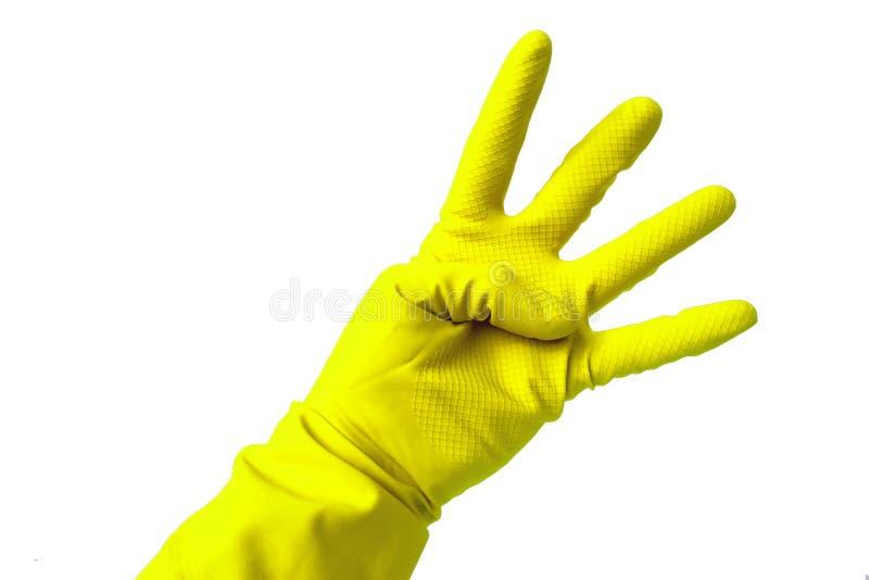 Παραδώστε το γάντι λατέξ που παρουσιάζει αριθμό τέσσερα στοκ φωτογραφίες