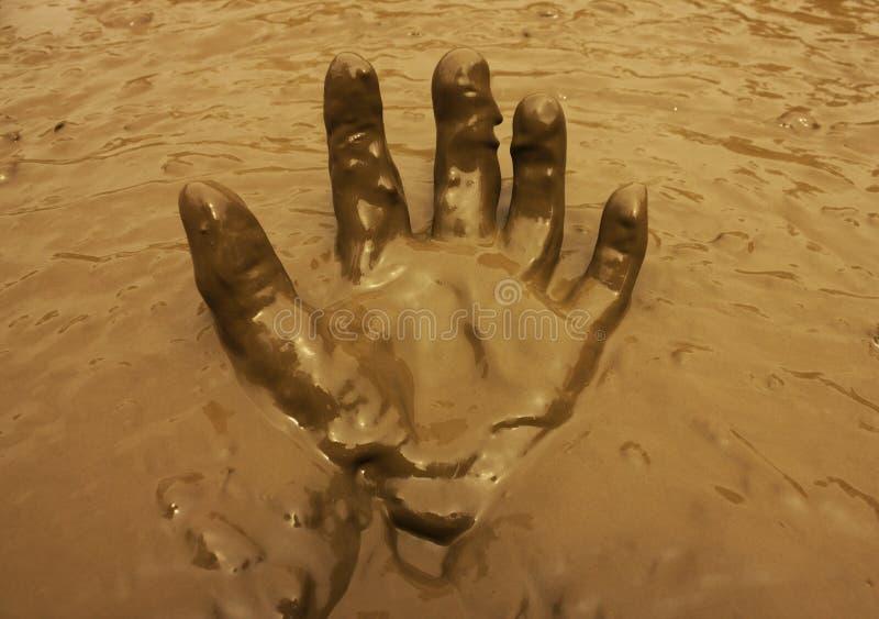 Παραδώστε το υπόβαθρο λάσπης στοκ φωτογραφίες