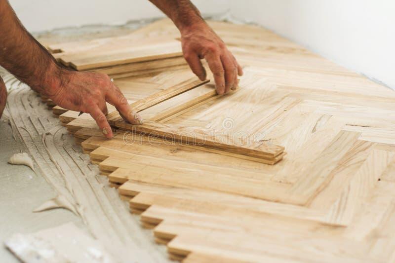 παρκέ έννοιας ξυλουργών στοκ φωτογραφία