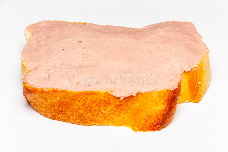 Πατέ που διαδίδεται σε μια φέτα ψωμιού στοκ φωτογραφία
