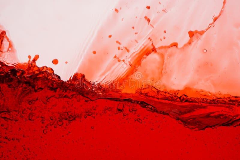 Παφλασμός κόκκινου κρασιού - κλείστε επάνω το αφηρημένο υπόβαθρο στοκ εικόνα