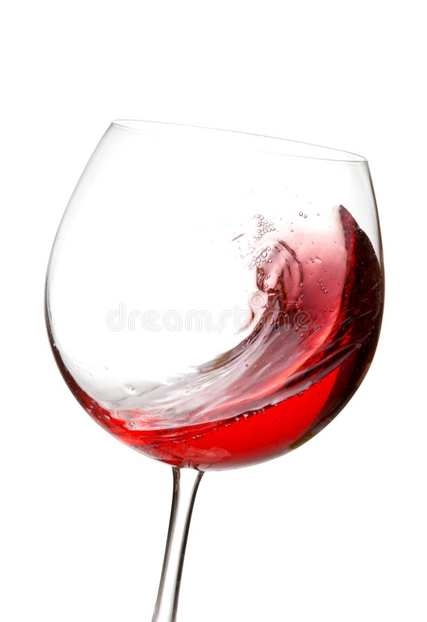 Παφλασμός κόκκινου κρασιού στο γυαλί στοκ εικόνες με δικαίωμα ελεύθερης χρήσης