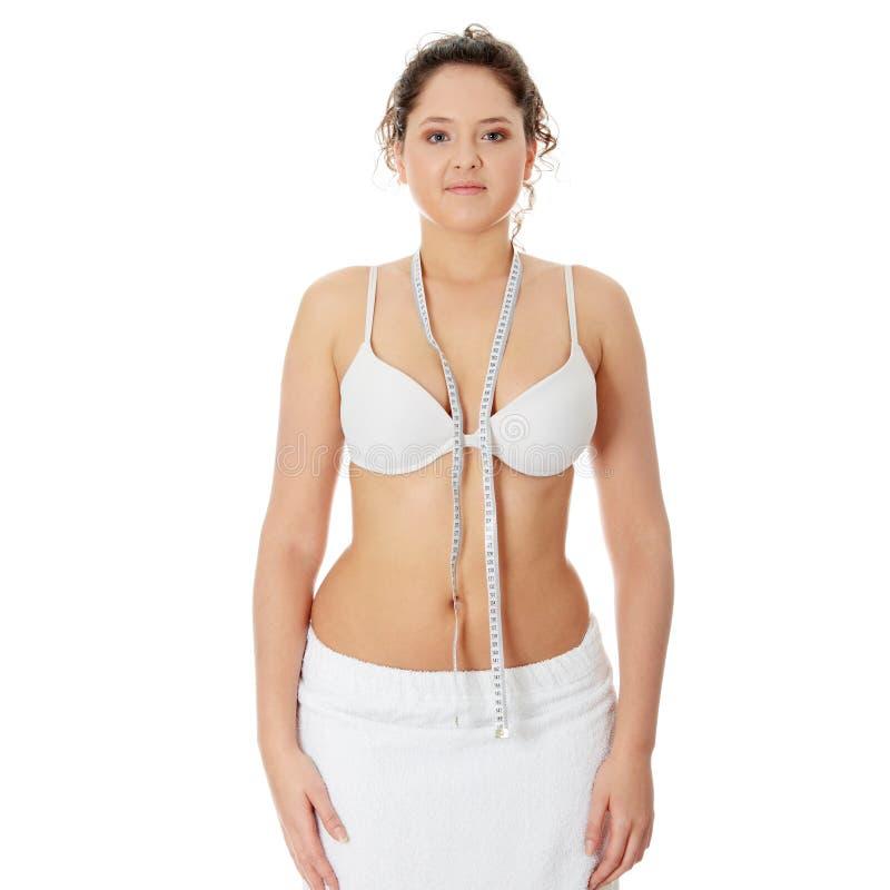 παχύσαρκη θηλυκή μετρώντα&si στοκ φωτογραφίες με δικαίωμα ελεύθερης χρήσης