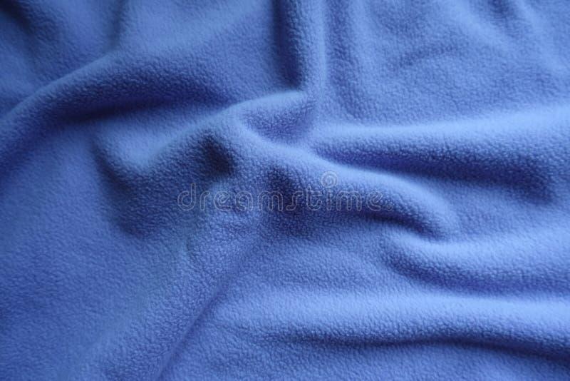 Παχύ μπλε δέρας στις μαλακές πτυχές στοκ φωτογραφίες με δικαίωμα ελεύθερης χρήσης
