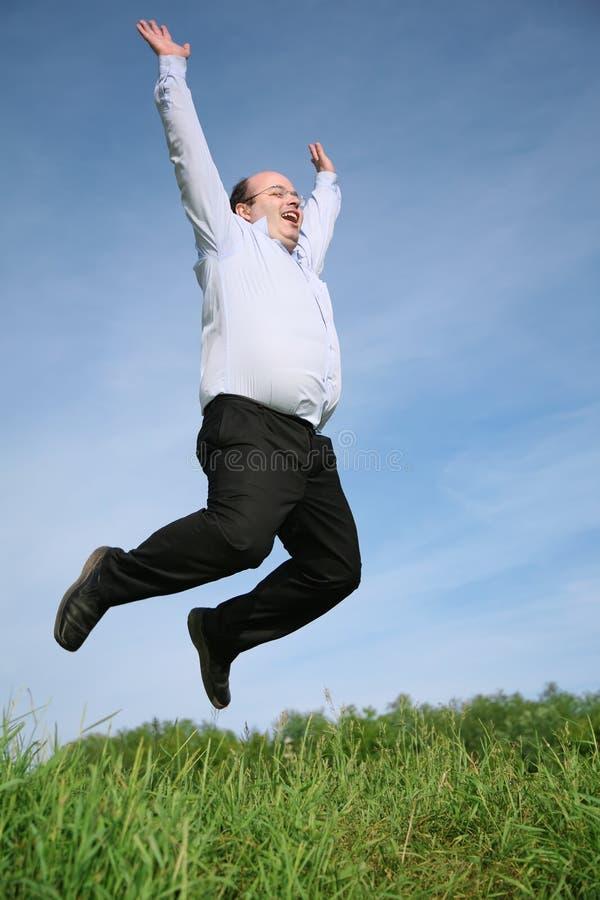 παχύ πηδώντας άτομο στοκ φωτογραφία με δικαίωμα ελεύθερης χρήσης