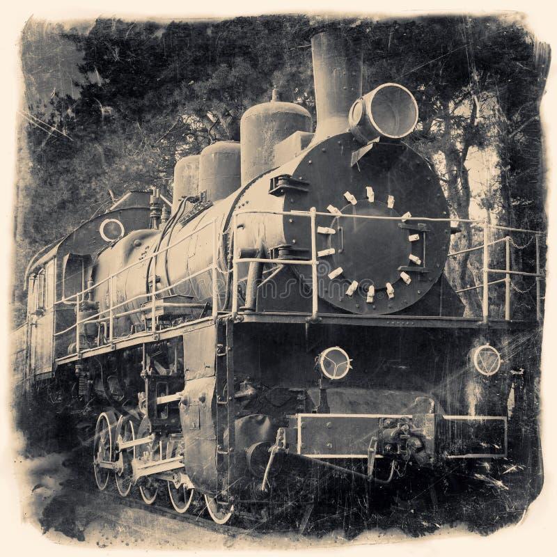 Παλαιά ατμομηχανή στο αναδρομικό γραπτό σχέδιο στοκ φωτογραφία με δικαίωμα ελεύθερης χρήσης