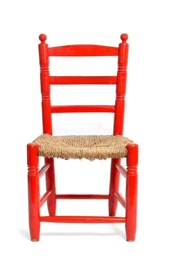 Παλαιά κόκκινη ψάθινη καρέκλα στοκ φωτογραφία με δικαίωμα ελεύθερης χρήσης
