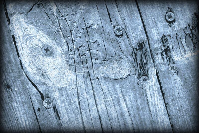 Παλαιά ξεπερασμένη ραγισμένη δεμένη Floorboards ξύλου πεύκων σκονών μπλε σύσταση Vignetted Grunge στοκ εικόνες