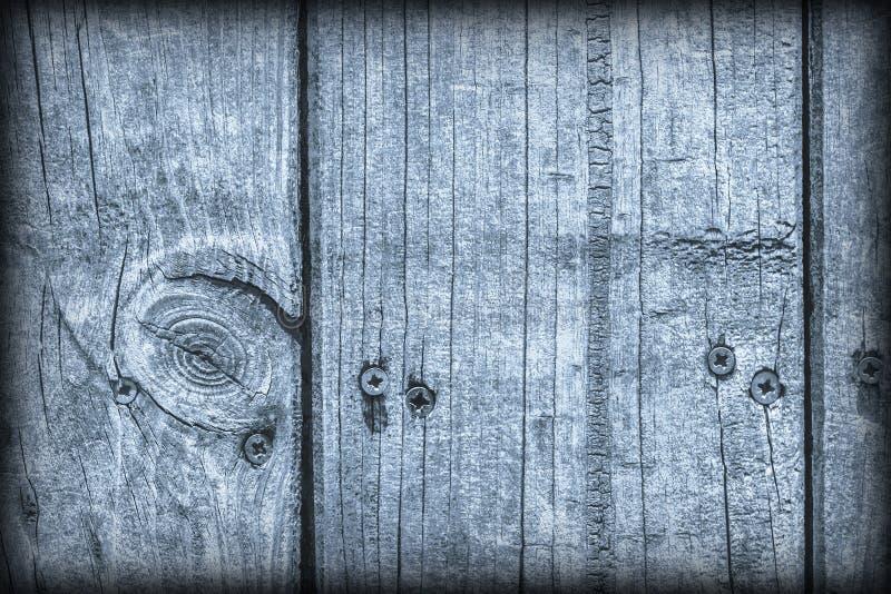 Παλαιά ξεπερασμένη ραγισμένη δεμένη Floorboards ξύλου πεύκων σκονών μπλε σύσταση Vignetted Grunge στοκ φωτογραφία