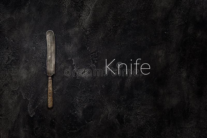 Παλαιό μαχαίρι grange στο σκυρόδεμα με τη τοπ άποψη κειμένων στοκ εικόνες