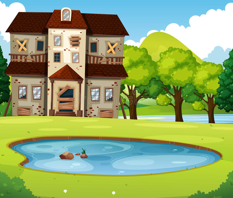 Παλαιό σπίτι τούβλου με το χορτοτάπητα και τη λίμνη ελεύθερη απεικόνιση δικαιώματος