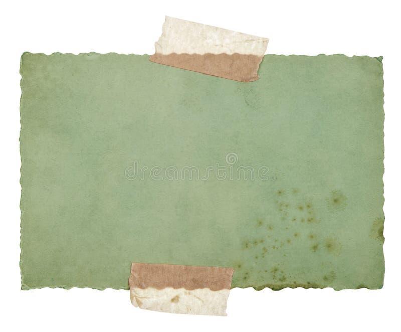 Παλαιό φύλλο Πράσινης Βίβλου με την ταινία που απομονώνεται στο λευκό στοκ εικόνα