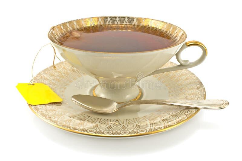 Παλαιό φλυτζάνι πορσελάνης με το τσάι στοκ φωτογραφία με δικαίωμα ελεύθερης χρήσης