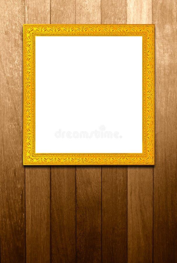 Παλαιό χρυσό πλαίσιο στο ξύλο pannels στοκ εικόνες