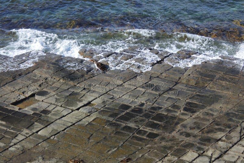 Πεζοδρόμιο Tessellated στη χερσόνησο Τασμανία Αυστραλία Tasman στοκ εικόνες με δικαίωμα ελεύθερης χρήσης