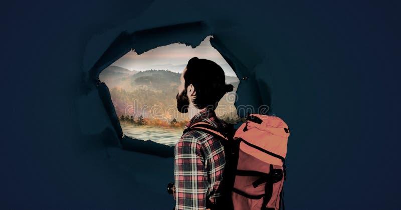 Πεζοποριες άτομο τυχοδιωκτών που εξετάζει μέσω της υπερφυσικής τρύπας εγγράφου το τοπίο φύσης απεικόνιση αποθεμάτων
