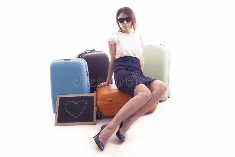 Περιμένοντας συνεδρίαση επιχειρηματιών πέρα από τις βαλίτσες της στοκ φωτογραφία