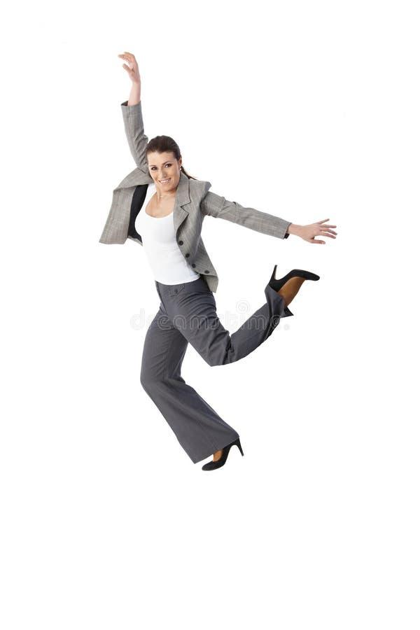 Πηδώντας κομψό χαμόγελο γυναικών στοκ εικόνες