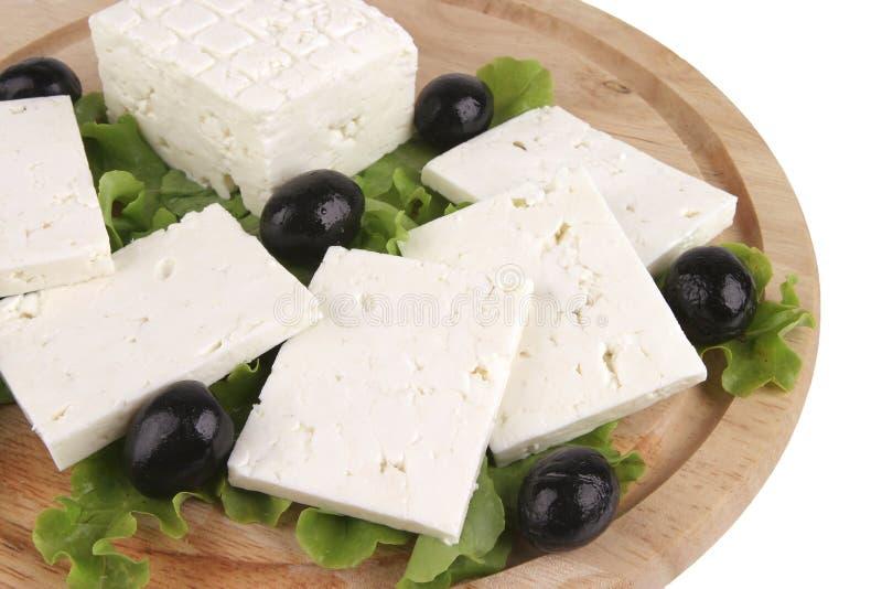 πιάτο φέτας τυριών ξύλινο στοκ εικόνες με δικαίωμα ελεύθερης χρήσης