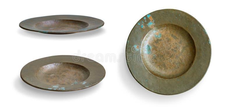 Πιάτο χαλκού στο λευκό στοκ εικόνες