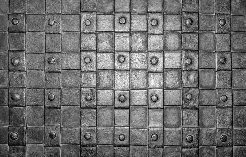 Πλέγμα και σφυρηλατημένο κομμάτι σιδήρου ως υπόβαθρο στοκ φωτογραφία με δικαίωμα ελεύθερης χρήσης