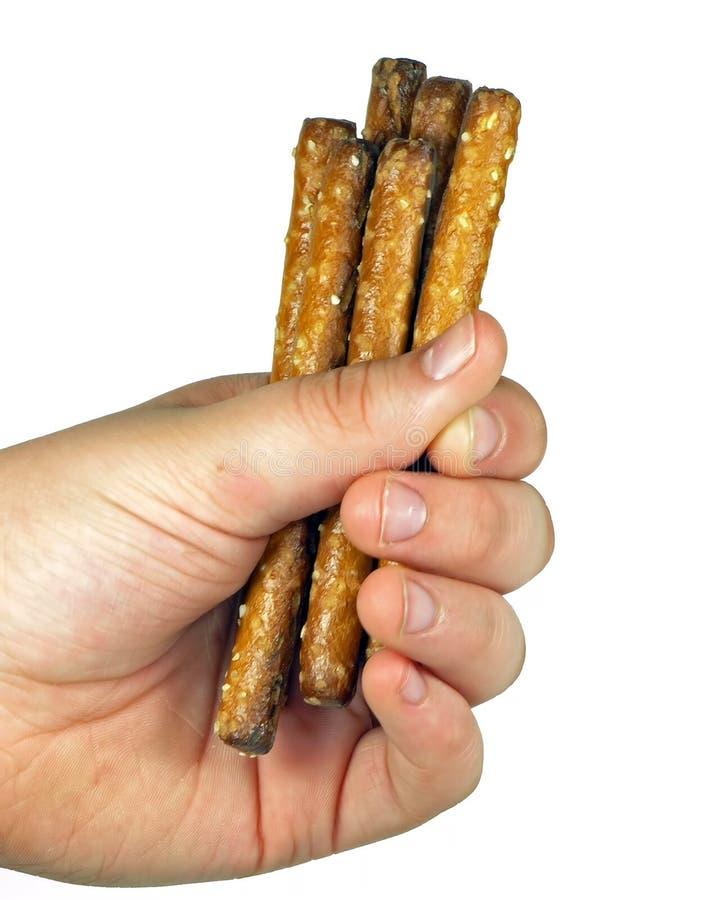 πλήρη pretzels χεριών στοκ εικόνες