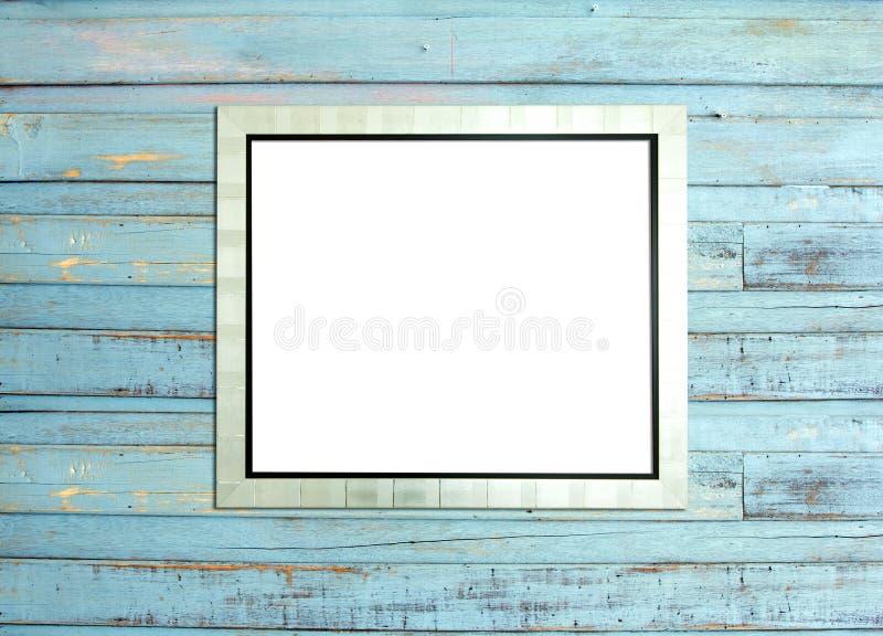 Πλαίσιο εικόνων SilveVintage στην μπλε ξύλινη ανασκόπηση στοκ εικόνα
