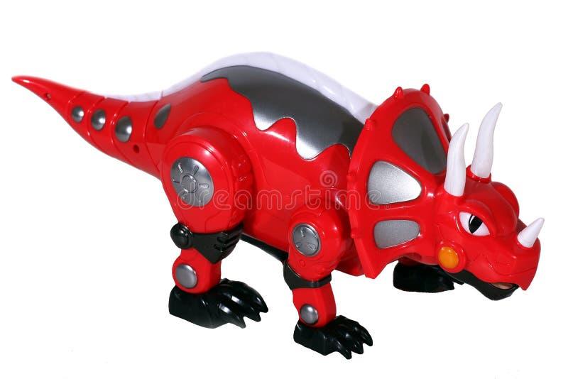 Πλαστικός κόκκινος δεινόσαυρος παιχνιδιών που απομονώνεται στο λευκό στοκ φωτογραφία