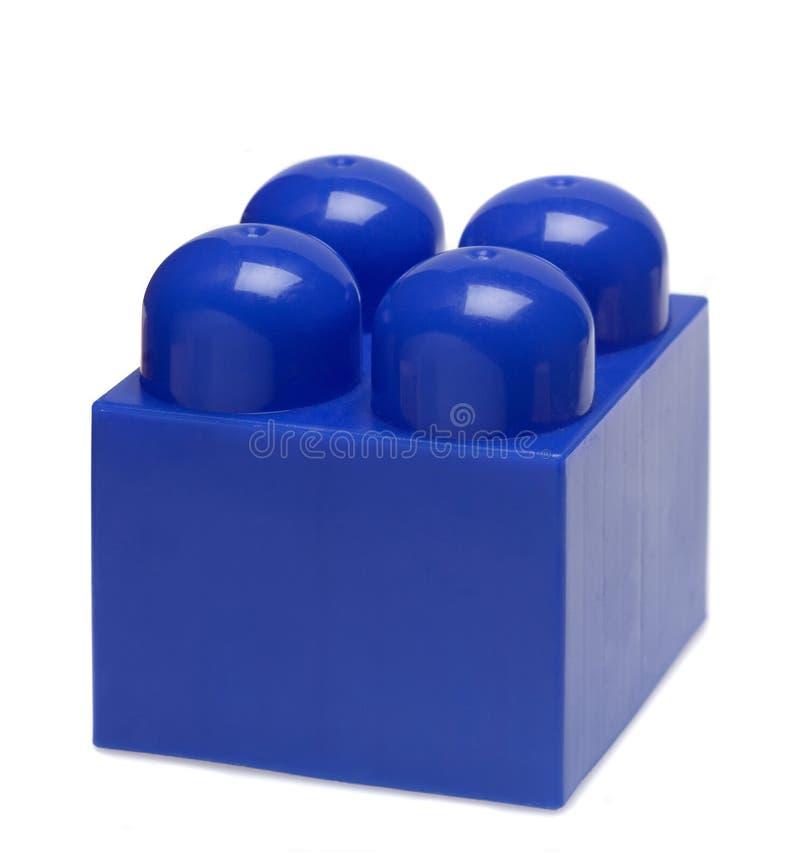 Πλαστικός μπλε φραγμός παιχνιδιών Απομονωμένος στην άσπρη έννοια στοκ φωτογραφία με δικαίωμα ελεύθερης χρήσης