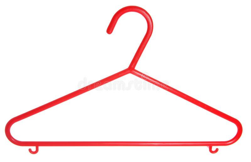 πλαστικό κόκκινο κρεμαστρών διακοπής παλτών παιδιών στοκ εικόνα με δικαίωμα ελεύθερης χρήσης
